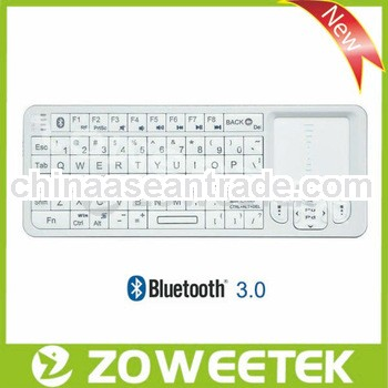 OEM/ODM white multi-language mini backlit bluetooth keyboard with integrated touchpad for android