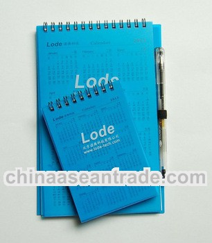 Blue PVC cover spiral notebook with pen