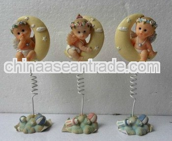 Small ceramic statues with stick