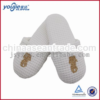 white embroidered waffle non-skid hospital slippers